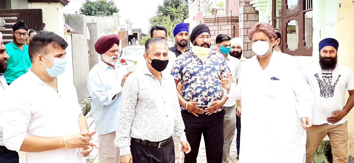 Cong leader Raman Bhalla interacting with people at Old Satwari on Friday.