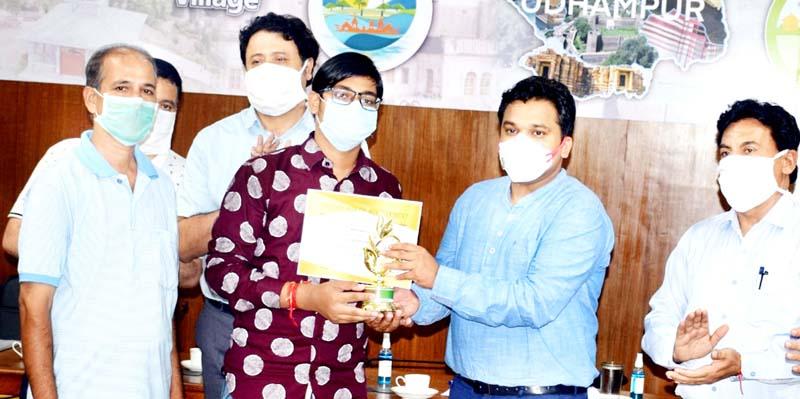 DC Udhampur Dr Piyush Singla enrolling school dropouts in Udhampur on Tuesday.