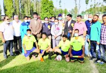 Dignitaries of Football tournament along with players posing for a group photograph at Baramulla.