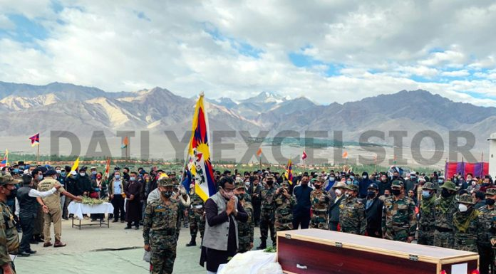 BJP national general secretary Ram Madhav, Army Commanders and others paying tributes to Indian Army's Tibetan brave heart, JCO Nyima Tenzin at Leh on Monday. -Excelsior/Morup Stanzin