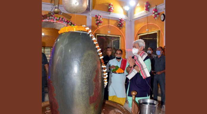 Lieutenant Governor Manoj Sinha praying at Ranbireshwar temple in Jammu on Monday.
