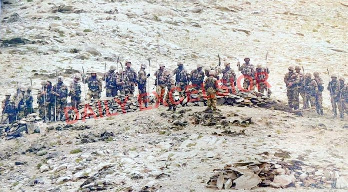 First photograph of Chinese PLA carrying sticks, swords and guns trying to intrude into Indian territory illegally near LAC in Eastern Ladakh.