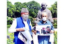 National Conference MP Farooq Abdullah staging a protest in front of the Mahatma Gandhi statue during Monsoon Session of Parliament in New Delhi on Saturday.(UNI)