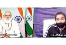 Prime Minister Narendra Modi inter-acts with Afshan Ashiq, the Kashmir's footballer on Thursday.