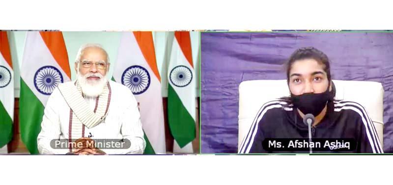 Prime Minister Narendra Modi inter-acts with Afshan Ashiq, the Kashmir's footballer on Thursday.