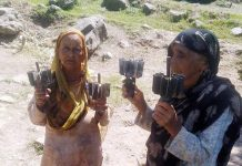 Women show mortar shells fired by the Pakistani troops in Balakote sector on Thursday. -Excelsior/Rahi Kapoor