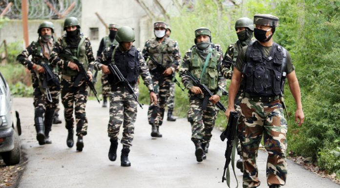 Security forces during encounter in Pattan on Friday. — Excelsior/Aabid Nabi