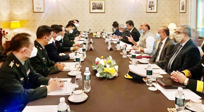 Defence Minister Rajnath Singh meeting Chinese counterpart General Fenghe in Moscow.