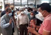 Advisor Rajiv Rai Bhatnagar faces people's queries in GMC Jammu on Wednesday.