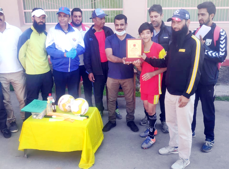 Officials of DYSS presenting trophy to winning team at Srinagar.