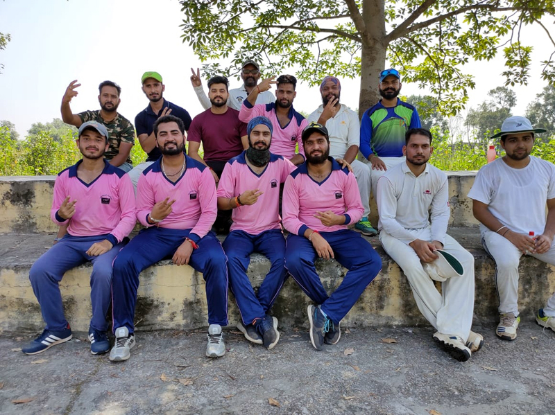 Winning team players posing for a group photograph after the match at Phallian Mandal Cricket Ground on Sunday.