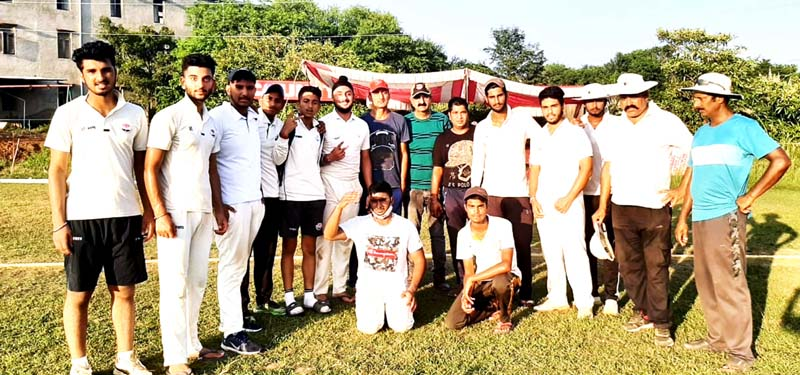 Dignitaries of match posing for a group photograph along with winning team at Country Cricket Stadium Gharota, Jammu.