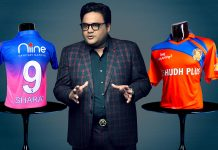 Sharat Khemka, an official of Niine posing with Rajasthan Royal's jersey with company's logo.