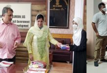Principal Secretary Dr Asgar Samoon distributing prize among winner students at Srinagar.