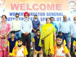 Dignitaries of Inter Zonal District Level competition posing for a group photograph with winners at DPS Udhampur.