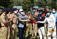 DGP, Dilbag Singh along with other officials presenting trophy to winning team at Anantnag.