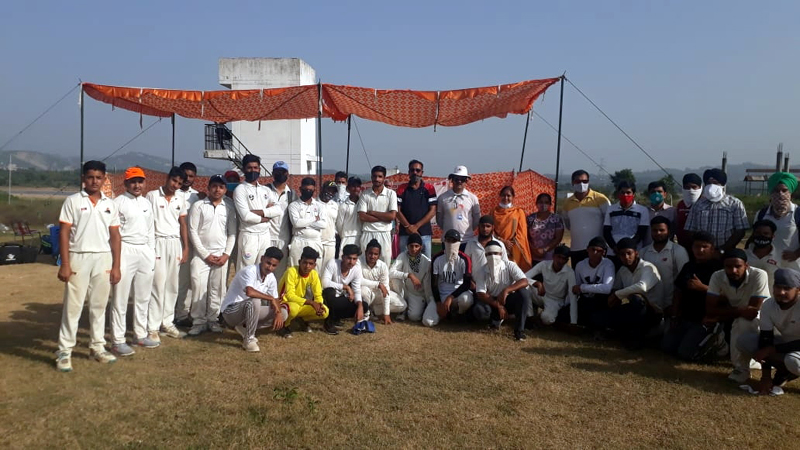 Winning team posing for a group photograph with dignitaries of the event at Khel Gaon Nagrota on Sunday.