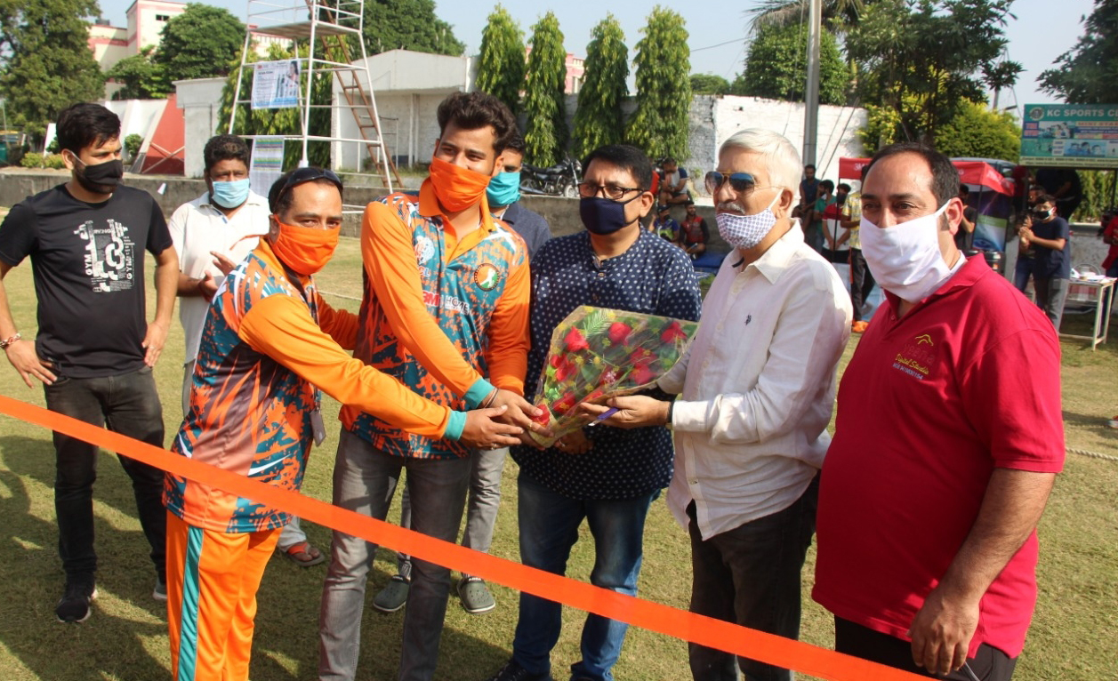 Dignitaries of the event inaugurating Kashmiri Pandit Cricket League at KC Sports Club Jammu on Monday.