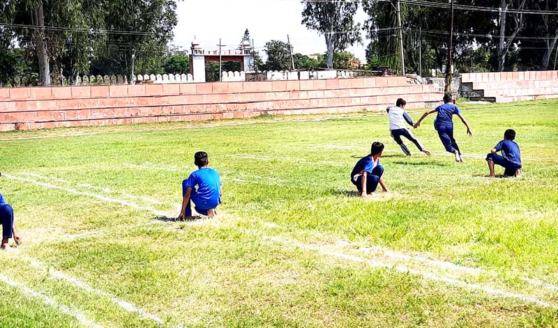 Kho-Kho players in action during the tournament at Sports Stadium Kathua.