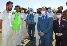 DC G N Itoo interacting with players at Baramulla. — Excelsior/Aabid Nabi