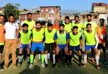 Players posing for group photograph after the match at Shaheed Millat Ground Lal Bazar Srinagar.