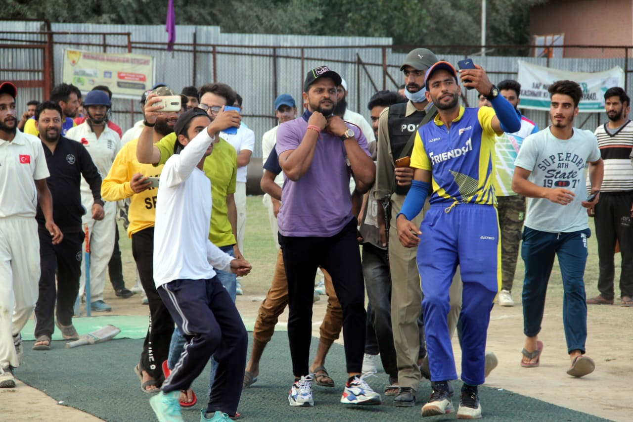 Local Youth taking selfie with former Indian Cricketer, Suresh Raina at Kunzar Play Ground, Baramulla.— Excelsior/Aabid Nabi