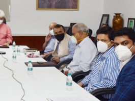 Union Minister Dr Jitendra Singh and Lieutenant Governor Manoj Sinha witnessing the formal signing of MoU to develop Kishtwar Airport under Centre's UDAN scheme, on Monday.