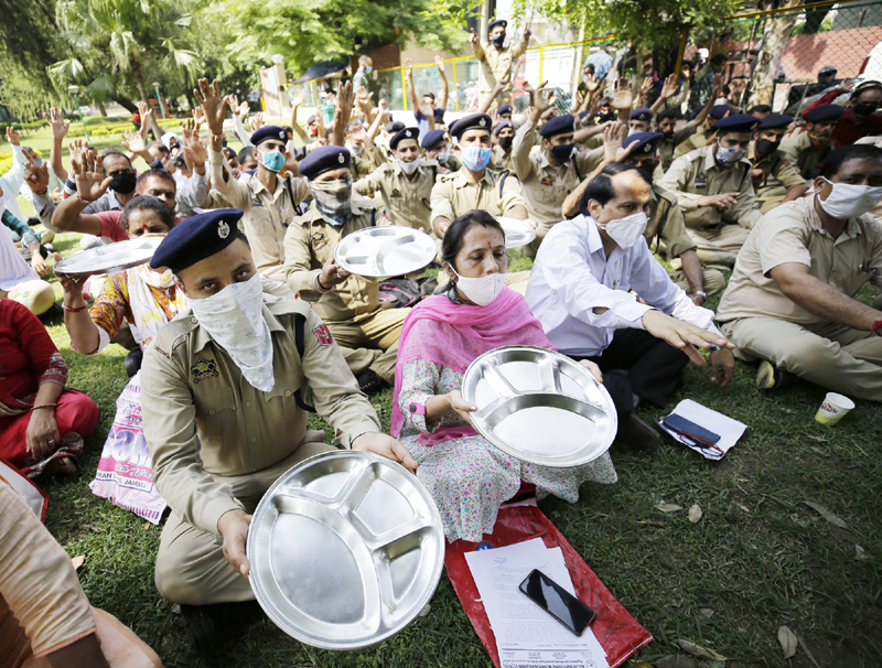 Home Guards protesting at Jammu on Monday. — Excelsior/Rakesh