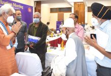 Lt Governor Manoj Sinha interacting with religious leaders at SKICC, Srinagar on Tuesday.