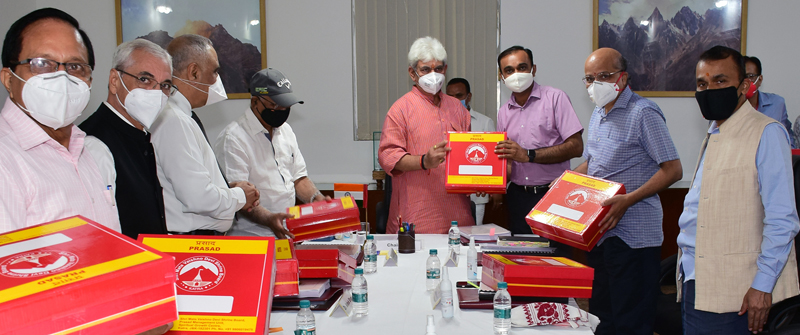 Lt Governor launching home delivery of Pooja Prasad during 67th meeting of SMVD Shrine Board on Monday.