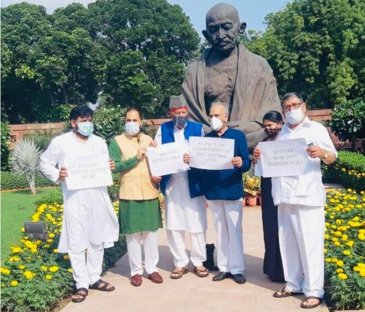 NC president Dr Farooq Abdullah and other MPs protesting near Mahatma Gandhi's statue in New Delhi on Tuesday.