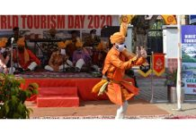 Artists performing during World Tourism Day celebration.