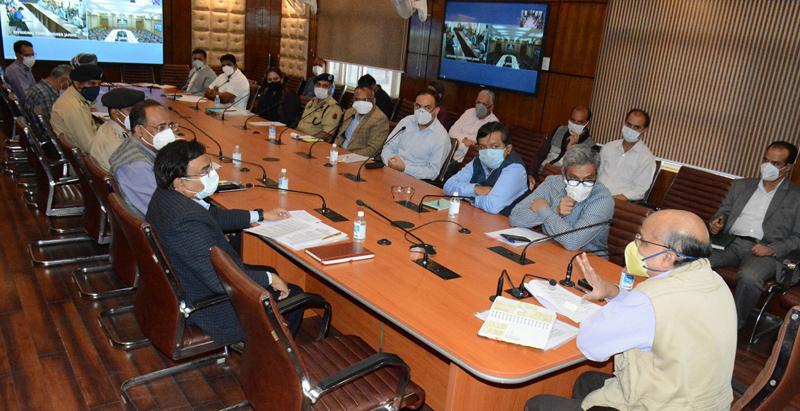 CS BVR Subrahmanyam chairing a meeting in Srinagar on Wednesday.