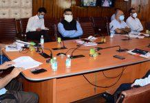 Chief Secretary BVR Subrahmanyam chairing a meeting in Srinagar on Thursday.