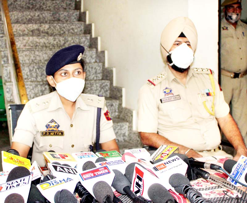 SP City Jammu PD Nitya interacting with media persons at Jammu on Friday. -Excelsior/Rakesh