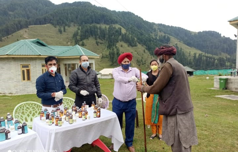 Director ISM distributing immune boosting medicines during a camp in Kathua district.