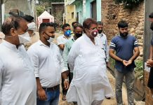 Former Minister Raman Bhalla interacting with people in Gandhi Nagar area on Sunday.