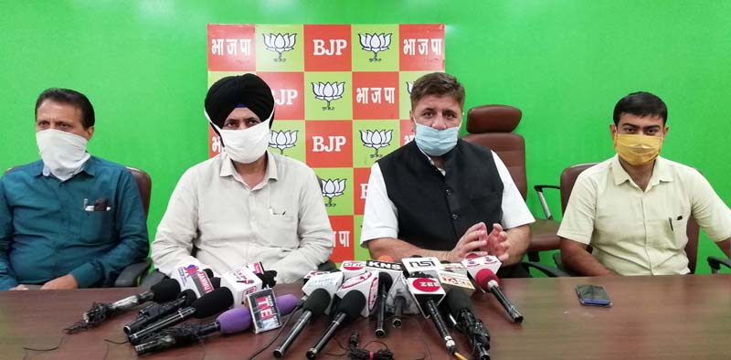 BJP leaders during a press conference at Jammu on Thursday.