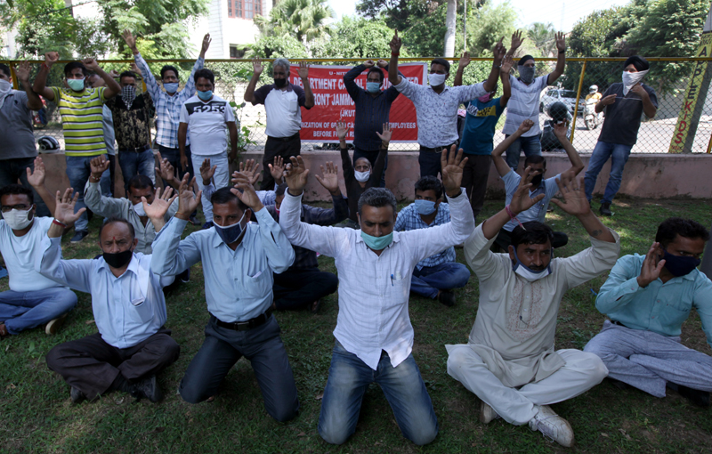 Need based workers of different departments during a protest at Jammu on Friday. -Excelsior/Rakesh