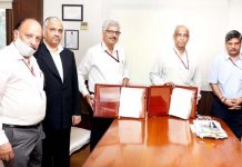Representatives of NHPC and Ministry of Power signing a MoU at New Delhi on Tuesday.