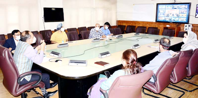 Principal Secretary Rohit Kansal chairing a meeting.