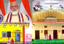Prime Minister Narendra Modi speaks while attending the 'Griha Pravesham' program being held in Madhya Pradesh for the inauguration of 1.75 lakh houses built under Pradhan Mantri Awas Yojana-Grameen (PMAY-G) scheme, through video conferencing, in New Delhi.