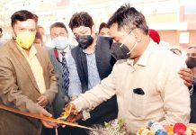 J&K Bank Chairman and Managing Director R K Chhibber inaugurating ATM at Degree College for Women Pulwama.