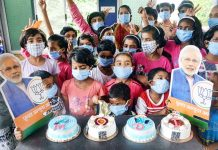 Children from Matruchaya Ashram celebrate Prime Minister Narendra Modi's 70th birthday, at Waghbil village in Thane.