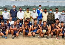 Officials of Department of Youth Services and Sports along with Volleyball winning team posing for a group photograph at Khel Gaon Nagrota Jammu.