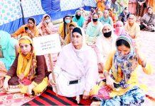 Punjabi speaking women staging protest in Jammu.