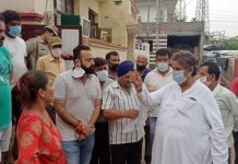 Senior Congress leader, Raman Bhalla interacting with locals of Ambedkar Nagar in Jammu on Tuesday.