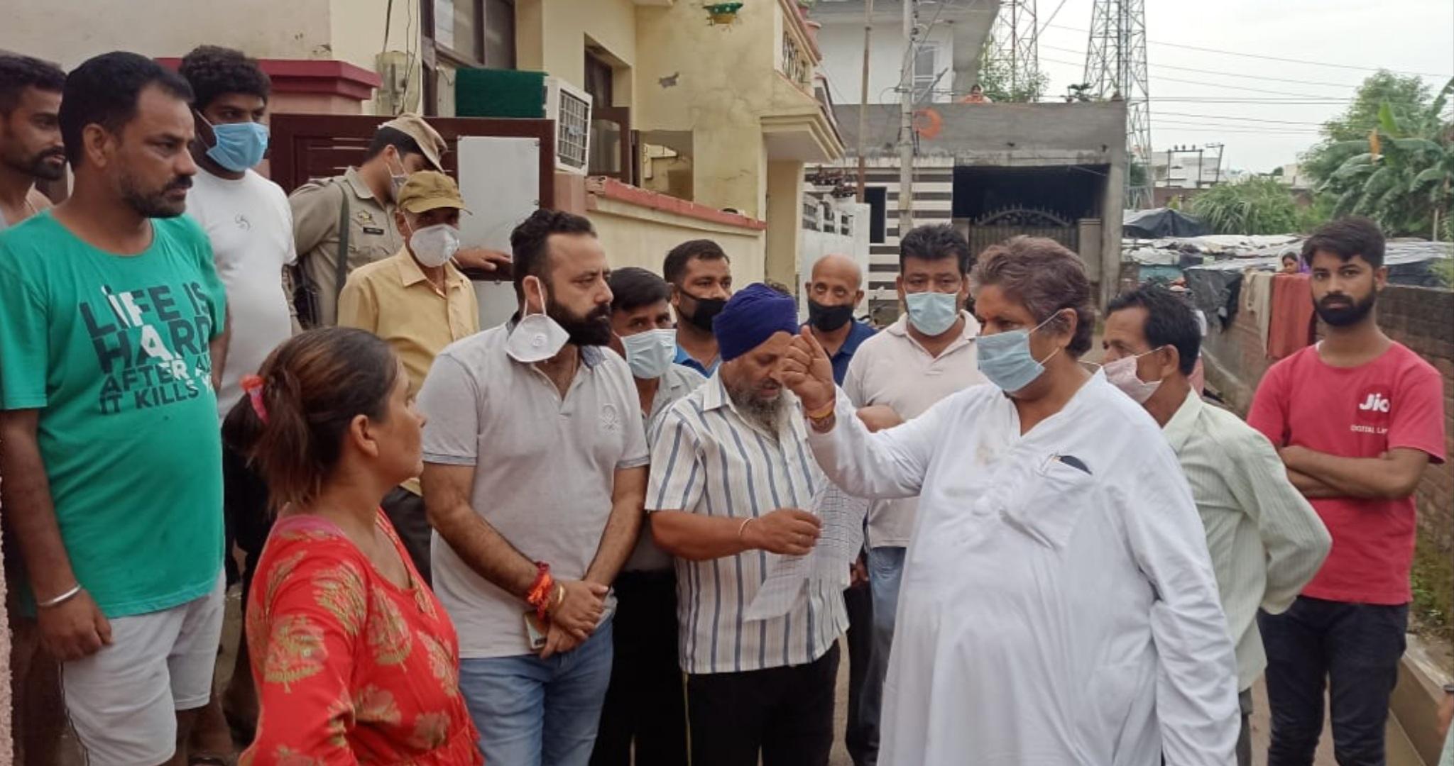 Senior Congress leader, Raman Bhalla interacting with locals of Ambedkar Nagar in Jammu on Tuesday.