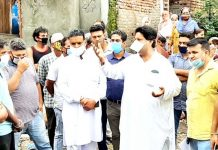 Raman Bhalla interacting with locals at Kacha Talab area of Bahu Fort on Sunday.