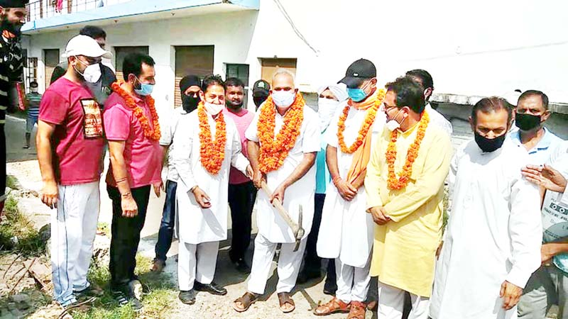 BJP leaders kick starting construction of lane and drain in Gangyal on Sunday.